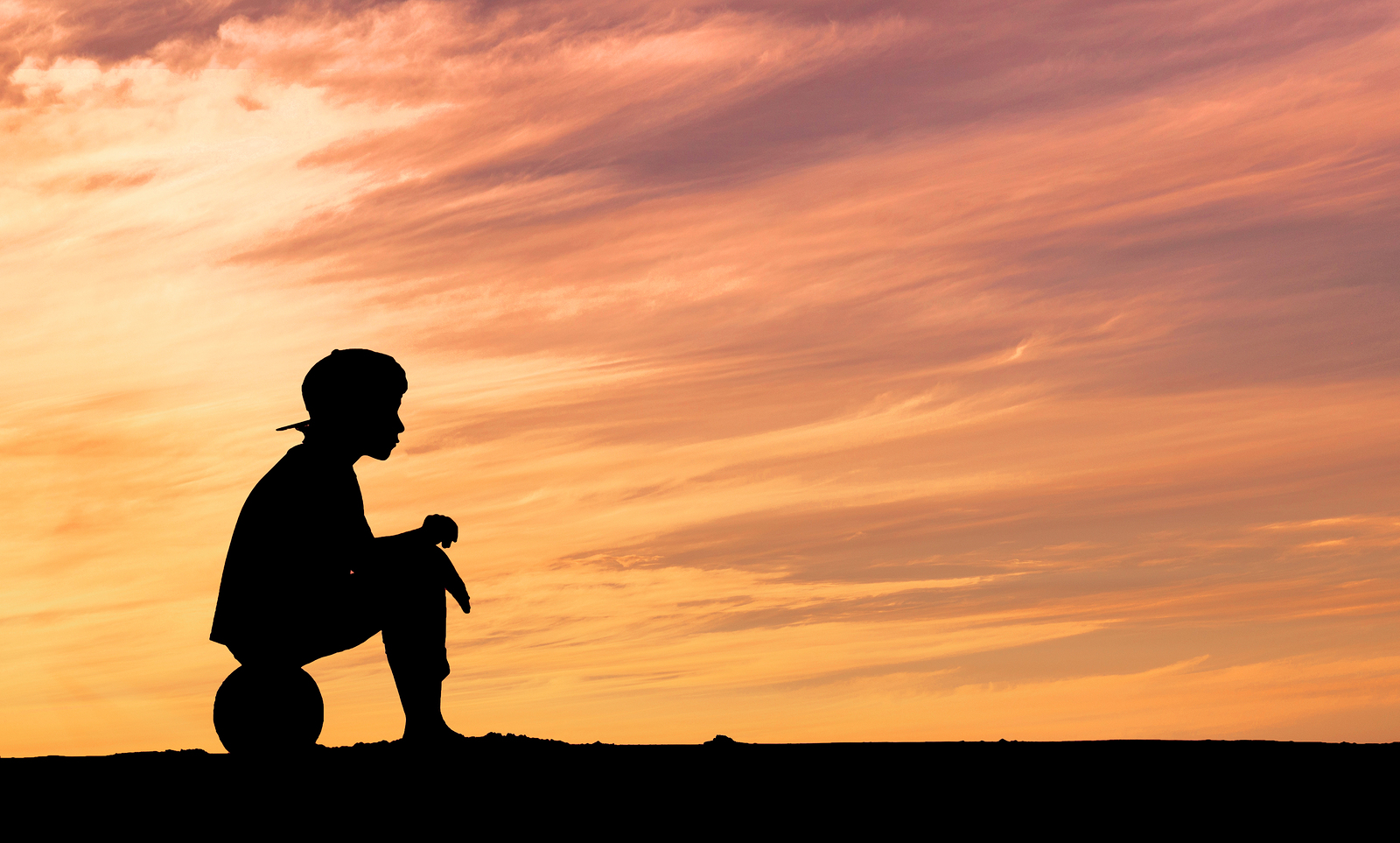 bigstock Silhouette of a boy sitting on 95675969